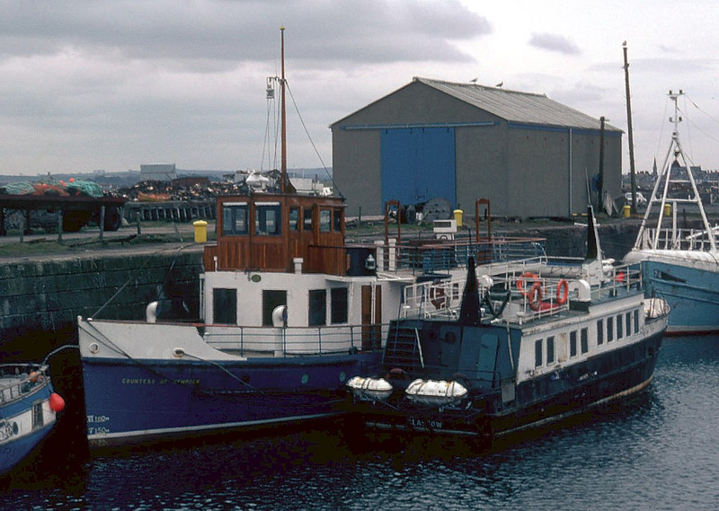 After Mr Ritchie's death in 1978 Countess of Kempock was sold to Offshore Workboats. For a few years she roamed further than before and found herself at Oban, not very far from her original area of operation on Loch Awe. She operated sailings to Iona and Staffa from Ulva Ferry under charter to Staffa Marine in 1979 and 1980. However, by early 1982 she was laid up in the inner harbour at Troon as seen here.