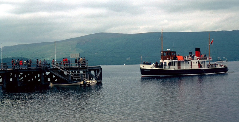 In service Countess Fiona made regular calls at Luss, Rowardennan, Tarbet and Inversnaid from her base at Balloch. In this view she is arriving at Luss.