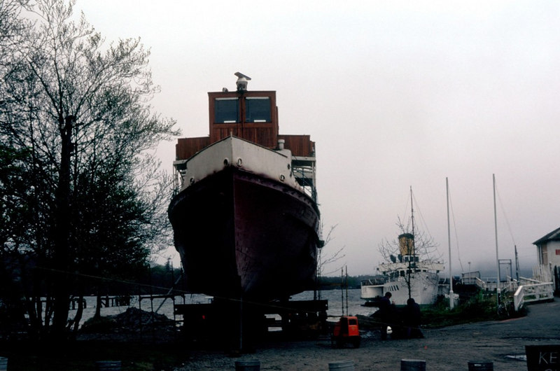 Maid of the Loch lies at Balloch pier, her future uncertain, while her successor sits high on the temporary ways, awaiting launch into the loch