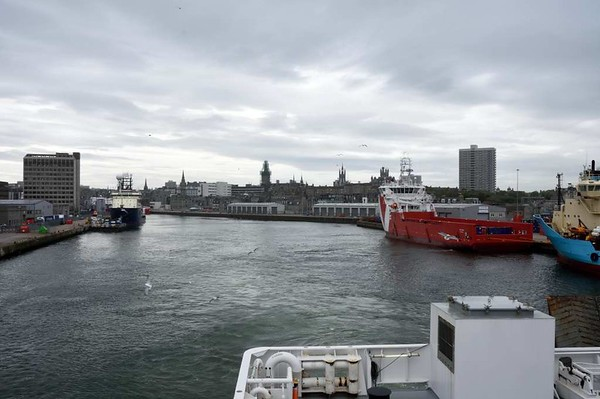 Leaving Aberdeen, 23 May 2015 - 1657.  Looking west as the Hrossey sets out for Kirkwall.  Grampian Surveyor is at left and Vos Pace (red) and Maersk Feeder are at right.