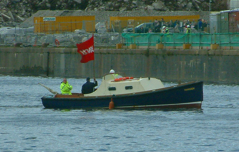 Mounts Bay launch day, 9th April 2004 <br /> <br /> As the time for Mounts Bay's baptism approaches, the tender Ranger hoists the traditional red and white 'Launch' flag that indicates to river users that the navigation is temporarily closed to allow the event to proceed.