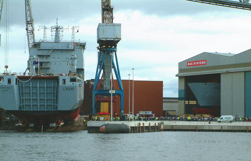 Mounts Bay launch day, 9th April 2004<br /> <br /> A view from Clyde Waterbuses' Pride o' the Clyde of Mounts Bay during final preparations for launch. Visitors arriving in the yard. Note bow section of Cardigan Bay in Bay 1 of the Module Hall waiting to come out to the berth after Mounts Bay is launched.