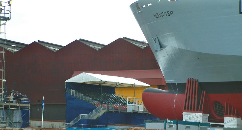 Mounts Bay launch day, 9th April 2004<br /> <br /> View shows the ship's bulbous bow and bow thruster and the temporary fore poppets that absorb the load tranferred onto the bow of the ship as the stern floats off the ways.
