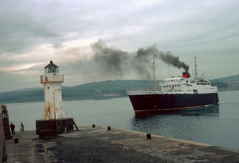 Clansman passing the lighthouse that marks the entrance to Ardrossan Harbour at the start of another voyage to Arran.