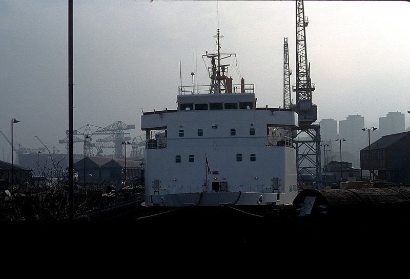 Claymore in the East India Graving Docks with the forest of cranes at the Cartsburn Dockyard beyond. Cartsburn Dockyard was operated by the Scott Lithgow Group. The Scott division was the oldest shipbuilding company in the world at that time, having been founded in 1712.