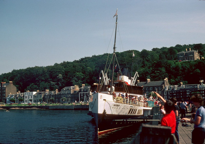 'Then Scotland's Madiera, that's Rothesay they say', the Capital of the Isle of Bute was living up to that title (from the Song of the Clyde) on this scortching hot day in 1982. <br /> <br /> As always there were 'laddies fishin fae the pier', apparently unmoved by the comings and goings of the paddler - well at least until the piermaster moved them.