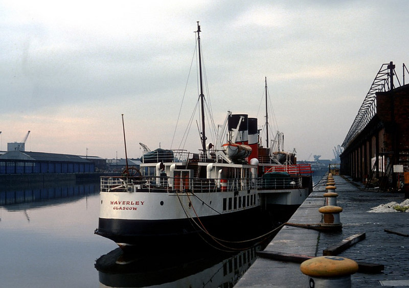 Following her sale to Waverley Steam Navigation, the World's Last Seagoing Paddle Steamer, Waverley, has been operated from a base at Anderston Quay, Glasgow from 1975 to 1977. With impending redevelopment of the quayside at Andeston Quay the WSN base moved to this location in one-time port warehouses and offices at Stobcross Quay. Across the river can be seen the old dockside sheds at Plantation Quay, a berth that would become the paddle steamer's base over 25 years later in 2004. After five years at Stobcross Quay the paddler's base was moved again, to allow for the redevelopment of the Queen's Dock and Stobcross Quay into the SECC. WSN and the paddler moved to No 35 Lancefield Quay, just downstream of the 1975 base. Subsequently, as the old dock sheds at Lancefield were redeveloped for residential purposes, the paddler moved her berth back to Anderston Quay although the offices remained in the Lancefield Quay building. The construction of the Clyde Arc bridge in 2005-06 forced the paddler to  relocate again her base berth, to Plantation Quay at the new Glasgow Science Centre, in 2004.