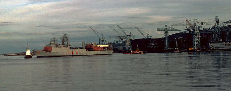 In 1982 the other part of Scott Lithgow, Scotts of Greenock (then the oldest shipbuilding firm in the world), was fitting out a specialist seabed operations vessel, HMS Challenger, for the Royal Nsvy. In this view the part complete Challenger is being manoeuvred off Scott's Cartsburn Dockyard by members of the the two tug fleets then operating on the Clyde - a unit of Cory (Clyde) Ship Towage (formerly Steel & Bennie) at the bow and one of the famous 'Flying' tugs of the venerable Clyde Shipping Company (said to be the oldest shipping company in the world at the time - est 1814) is controlling the stern.