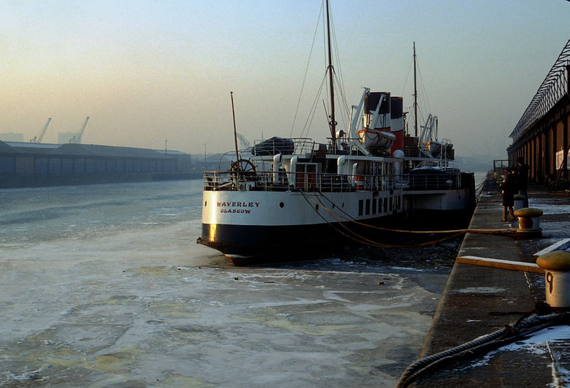 In January 1982, Glasgow and the West of Scotland experienced its most prolonged period of deeply sub-zero temperatures for many years. Temperatures remained around -20oC for almost 3 weeks and the River Clyde had a thick covering of ice from bank to bank as far downriver as Govan. This view shows Waverley,  frozen in a Stobcross Quay.
