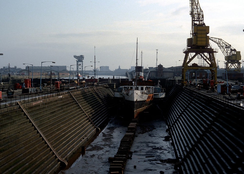 Another view of Waverley in No 2 Dock at the historic Govan Graving Docks, which are partly built on the site formerly occupied by the shipyard of Robert Napier, the Father of Clyde Shipbuilding and designer of the first transatlatic ships of the famous Cunard Line. No 1 Dock on the left, No 3 Dock on the right<br /> <br /> Above and to the right of Waverley is the former Clyde Navigation Trust control tower at the entrance of Princes Dock. The position of the control tower is now occupied by the unfortunate Glasgow Tower and most of the Princes Dock, like the former Queens Dock across the river, has been filled in and obliterated, almost without trace.