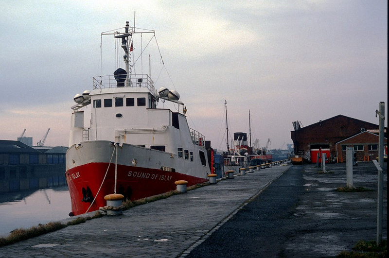 At the start of 1982 the groundbreaking Western Ferries' vessel Sound of Islay was laid-up, under the attention of Waverley Steam Navigation Company staff, at the paddle steamer's then basr at No 52 Stobcross Quay. Sound of Islay and Waverley are seen here alongside the WSN worskshops and office building at Stobcross Quay. These were in a location now occupied by the Crowne Plaza Hotel (originally the Forum Hotel when opened in 1989).