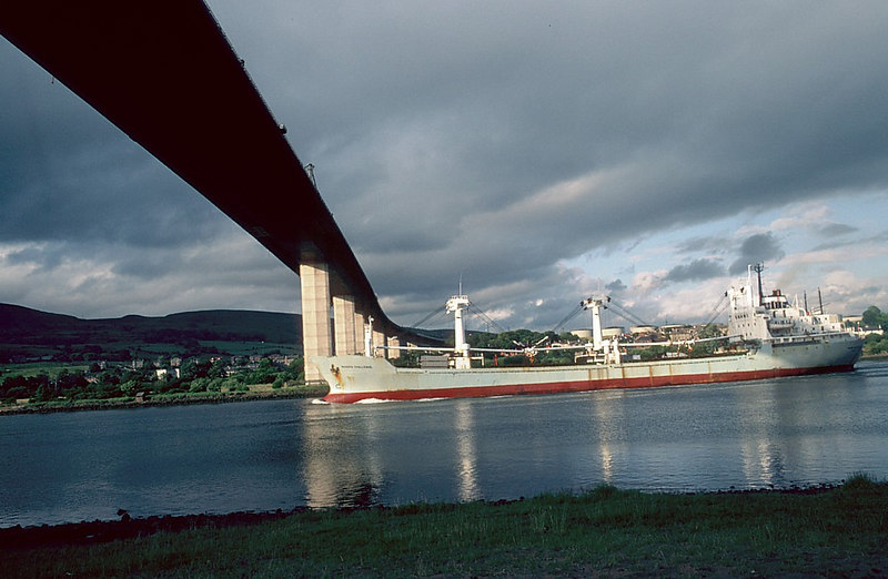 In the early 1980s significant parts of the British mechant marine was still intact. The same could not be claimed 10 years later. In this view the Liverpool-based Booker Line's cargo vessel Booker Challenge is seen passing downriver under Erskine Bridge after a visit to Glasgow's King George V Dock. Booker Line vessels were regular visitors to the Clyde until their demise in the 1980s.