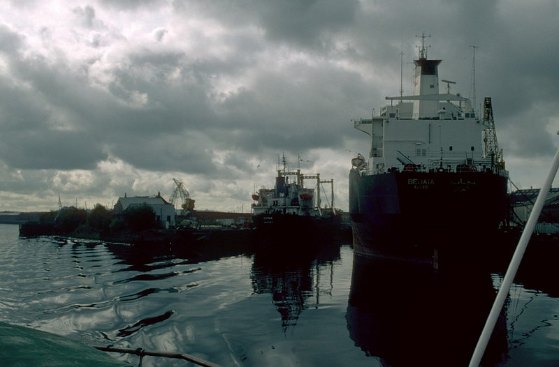 At the former Harland & Wolff fittingout basin two vessels were under repair by ClydeDock Engineering, the smaller vessel on the left is the motor vessel Dyna while the large vessel on the West side of the dock was the Algiers-registered Bejaia