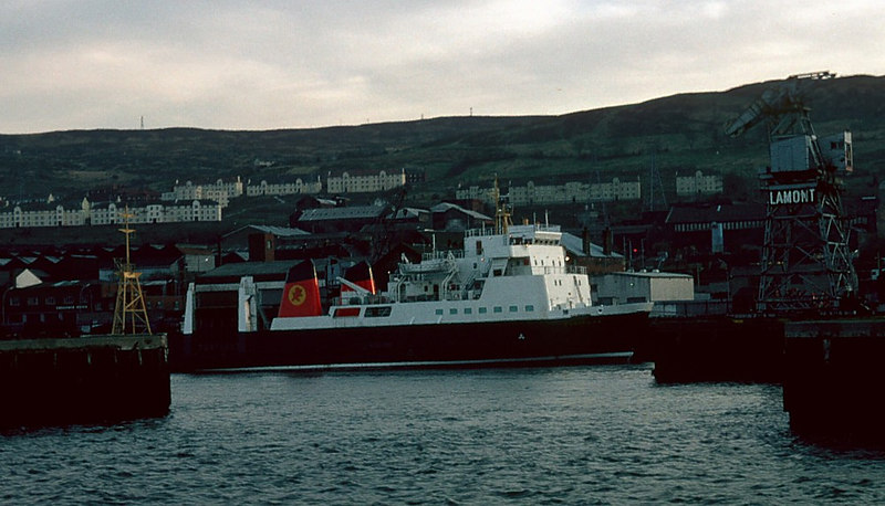 In 1982 there was still four operational ship repair yards on the Clyde - one in Govan, two in Greenock and one at Troon. Here we see the Caledonian MacBrayne ferry Claymore undergoing her annual repair and maintenance in the yard, at Greenock's East India Harbour, long operated by James Lamont & Company. Claymore was the third vessel of name to operate on the west coast of Scotland since 1881, having been built in 1978 at the Robb Caledon shipyard at Leith on the Firth of Forth. In her early career she operated normally between Oban and the islands of Barra and South Uist.