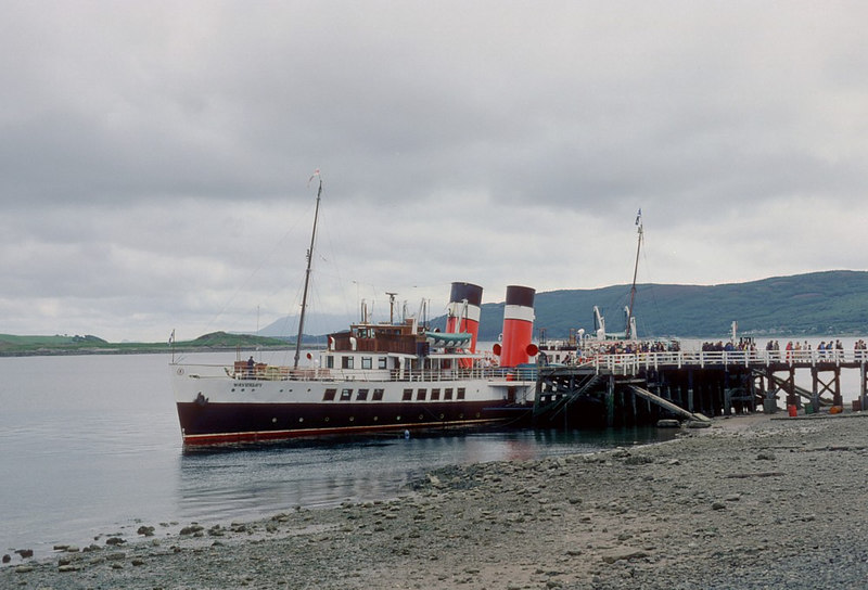 If its a summer Saturday it must be Tighnabruaich. In this 1982 shot, at near low water, Waverley is berthed 'port side to' for a quick getaway when her passengers have returned from 'Suzy's' and the other delights of the West Kyle village.