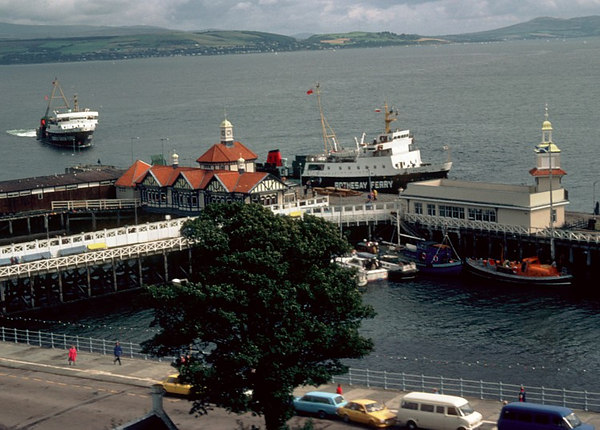 The normal Rothesay ferry Saturn leaving Dunoon as the initial ferry of this type, Jupiter, approaches on the main service from Gourock