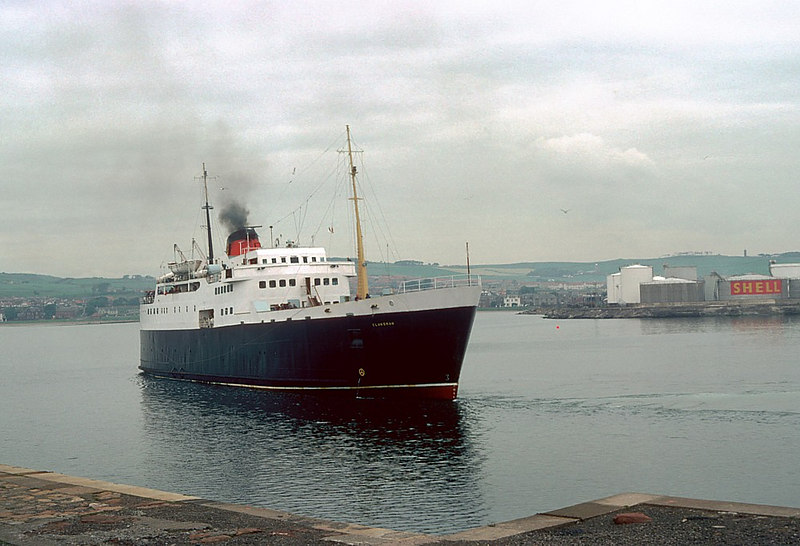 After exchanging vehicles and passengers, Clansman going astern to cant off Winton Pier, Ardrossan. The former Shell terminal at Montgomerie Pier can be seen in the background. By 2006 that area had become a large marina and residential development.