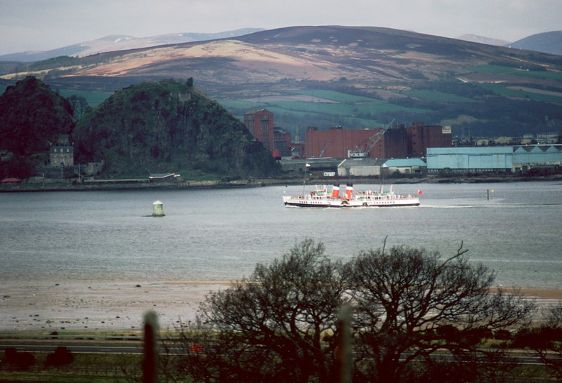 Waverley passing Dumbarton in 1982 when some remnants of the former Denny shipyard and Blackburn aircraft factory still remained. Also note the tall red brick buildings of the Hiram Walker distillery, built on the site of the former A McMillan shipyard, was still in production at the time.