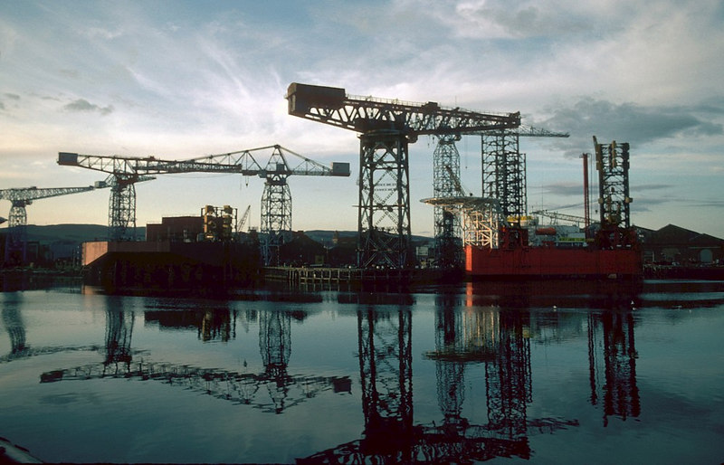 Marathon Manufacturing were constructing offshore structures at the former John Brown shipyard in Clydebank in 1982. The Jack-up Drill-rig in the fitting out basin, under the Arrol crane, is the Morecambe Flame while the larger rig under construction in the West Yard is the Bay Driller.<br /> <br /> A total of 20 Jack-up Drill-rigs were built at Clydebank over a 21 year period from 1965 to 1986
