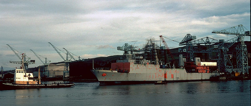 HMS Challenger and tugs at Scotts Cartsburn Dockyard