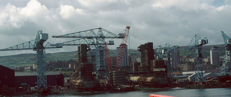 """The massive jacket structure of Sea Explorer(Scott Lithgow Yard No 2001) under construction across two shipbuilding berths at Cartsburn Dockyard<br /> <br /> Correction and additional information, courtesy of Tom Carreyette<br /> <br /> """"These are the pontoons and columns for Yard No. 2001, SEA EXPLORER which were later braced together at the top and launched from the two berths as one. See additional comments on previous picture."""""""
