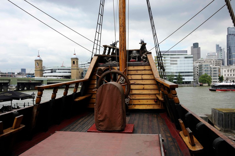 Command deck, Golden Hinde II, Southwark, London, 3 September 2013 1.  Looking north across the Thames to the City of London, with Cannon Street station at left.  The original Golden Hind was steered with a whip staff lashed to the rudder, not with a wheel.