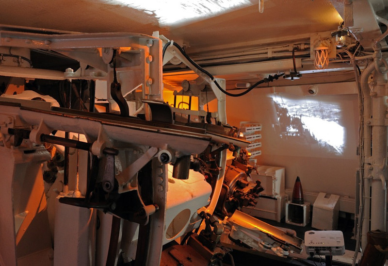 HMS Belfast, London, 3 September 2013.  Inside X turret.  It has an audio-visual display which simulates the three guns' firing a salvo.  Each 6-inch gun turret had a crew of 27.