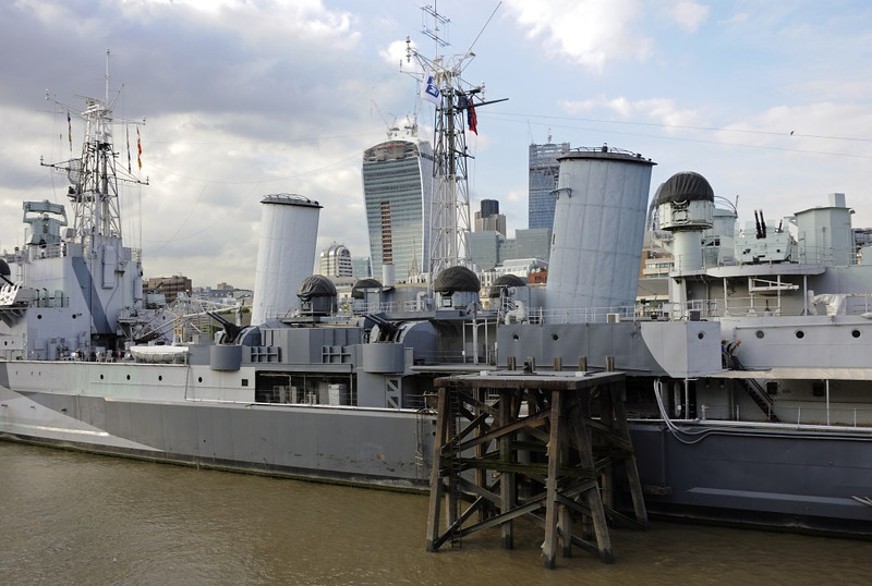 HMS Belfast, London, 3 September 2013.  Left and centre are the two port 4-inch twin mountings and their blind fire directors.  The aft port Bofors 40mm mounting and its blind fire director are at right.