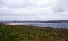 Churchill barrier No 1, Orkney, 26 May 2015.  Looking north west from near the Italian chapel on the island of Lamb Holm (foreground) towards the Orkney mainland.  The Scapa Flow anchorage is just visible in the distance at left, beyond Howequay Head.  The stretch of water between Lamb Holm and the mainland is Kirk Sound.  Early on 14 October 1939 U-47, commanded by Kapitanleutnant Gunther Prien, evaded blockships that had been sunk in the sound and entered Scapa Flow while surfaced.  He torpedoed and sank the battleship HMS Royal Oak with the loss of 833 men before making his way back past the blockships into the North Sea.  His was not the first U-boat to attempt to enter Scapa flow.  There had been two attempts during the First World War; both U-boats were detected and destroyed.  The loss of Royal Oak in a supposedly secure naval anchorage was a stunning shock, and Churchill ordered the construction of four barriers between islands on the eastern side of Scapa Flow to prevent a repetition.