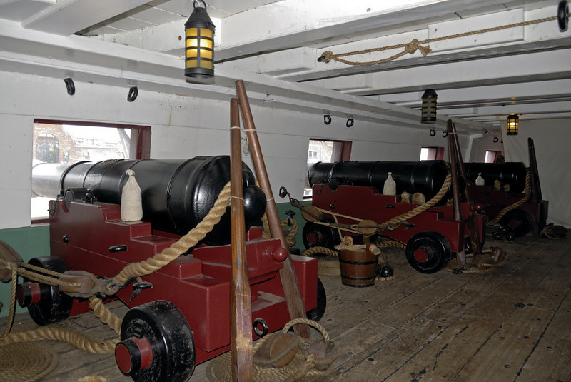 HMS Trincomalee, Hartlepool, Tues 10 August 2010 18.  If Trincomalee had been commissioned when built, her main armament of 28 18-pounders would have been mounted on the gundeck as these replicas illustrate.  These guns were obsolete by the time she did actually commission in 1847, so she was given fewer but more powerful guns, 26 in all.  On her gun deck were 12 heavy 32-pounders firing solid shot and six 8-inch guns firing explosive shells.  On the quarterdeck were two 56-pounders and six light 32-pounders, all firing solid shot.