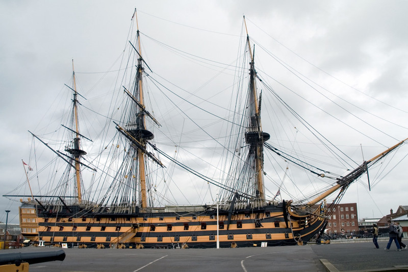 HMS Victory, Portsmouth, 6 March 2007 2.  The overall length of Victory's hull is 227 feet 6 inches, and it is up to 50 feet wide.  The main masthead is 205 feet above the sea.  819 men were aboard at Trafalgar, of whom 159 became casualties.