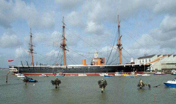 HMS Warrior, Portsmouth, 5 March 2007 1.  Warrior is an armoured frigate built on the Thames at Blackwall, east London, in response to the French ironclad Gloire and commissioned in 1861.  Warrior was also an ironclad, having an iron hull clad with teak and wrought iron armour, and steam (screw) and sail propulsion.