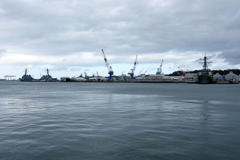 US Fleet Activities base, Yokosuka, 21 March 2019.  At left are two Arleigh Burke destroyers, one of them USS Barry, and a submarine.  USS Stethem, another Areleigh Burke, is at right.