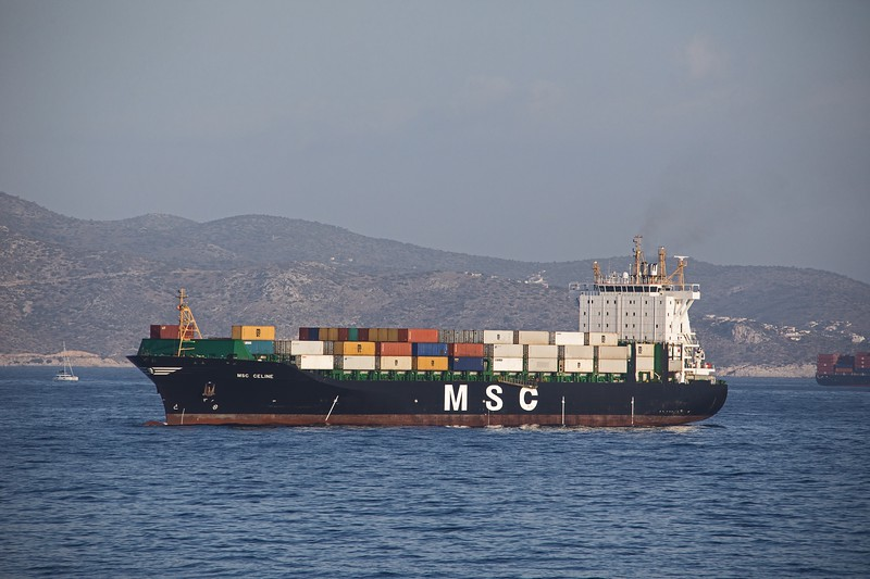 MSC Celine is stopped and awaiting entry to Piraeus container port after arriving from the Italian Port of Civitavecchia. Built in 2007 she has a GT of 32060