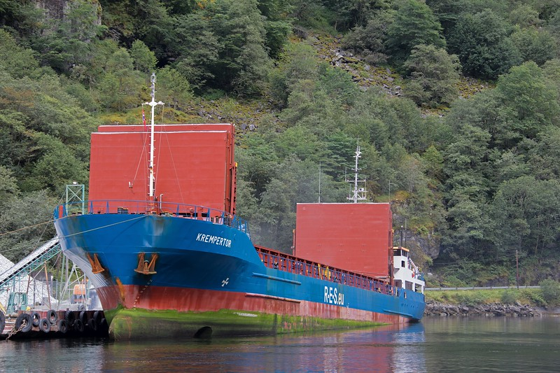 KREMPERTOR seen at Gudvangen, Norway, loading stone on 16th August 2017. Flagged in Antigua Barbuda, this 1990 built ship has a GT of 2351.