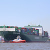 Evergreen's 'Ever Lawful' underway with tugs in the Port of Hamburg on 12th June 2015.  This Singapore registered container ship has a TEU of  8452 and is 98,830GT.