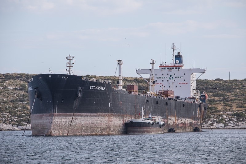 Originally built in 1977 as the 'Keymar'...the Ecomaster is seen here  opposite the shipyards of Perama. This Liberian flagged ship is shown as a 'waste disposal vessel' and has clearly not moved for a very long time