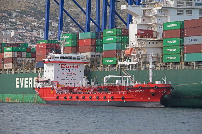 The 4568 GT product tanker Cptn Kostas on 'bunkering' duties to the container vessel 'Ever Conquest' in Piraeus on 18th April 2017. Built in 2010, she is flagged in Greece.