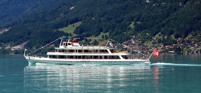 Motor vessel Brienz from paddle steamer Lotschberg aas they pass off Iseltwald