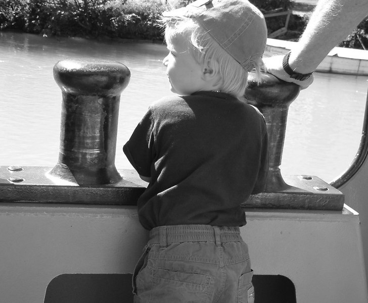 At Interlaken Ost (East) we boarded the paddle steamer Lotschberg to sail along the length of Lake Brienz - this young man had already reserved his viewing spot where the steamer's side plating lowers at the forward mooring bitts - the place seemed to be made for him.