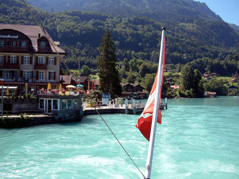 View aft from paddle steamer Lotschberg as she departs from Iseltwald on the southern shore of Lake Brienz
