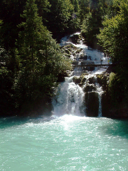 The lowest part of Giessbach's spectacular waterfalls from paddle steamer Lotschberg as she departs for Brienz