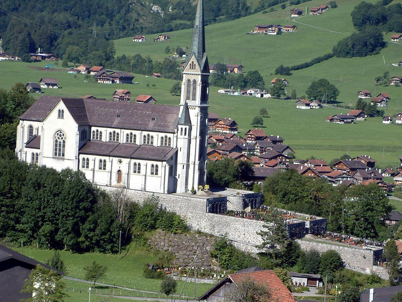 The huge church of Lungern built on a massive stone plinth on the hillside above the town