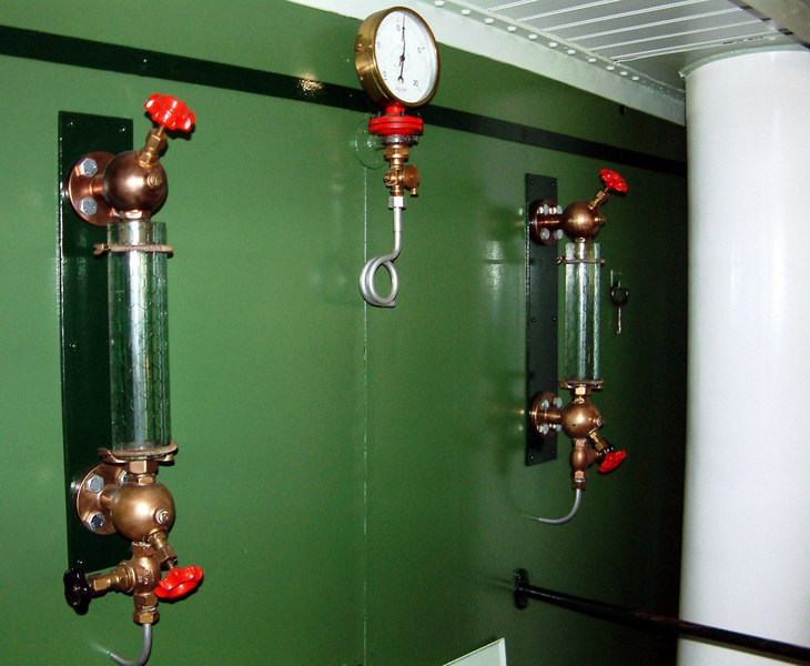Lotschberg's main steam line pressure gauge and boiler water level indicator glasses on the outside of the main deck flue casing