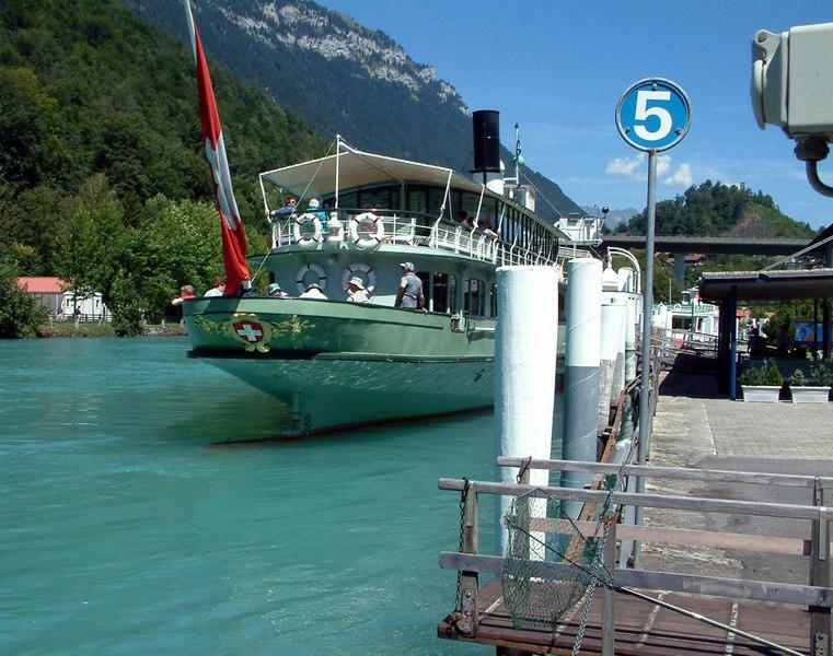 Paddle steamer Lotschberg at her base at Interlaken from astern beside Interlaken Ost railway station