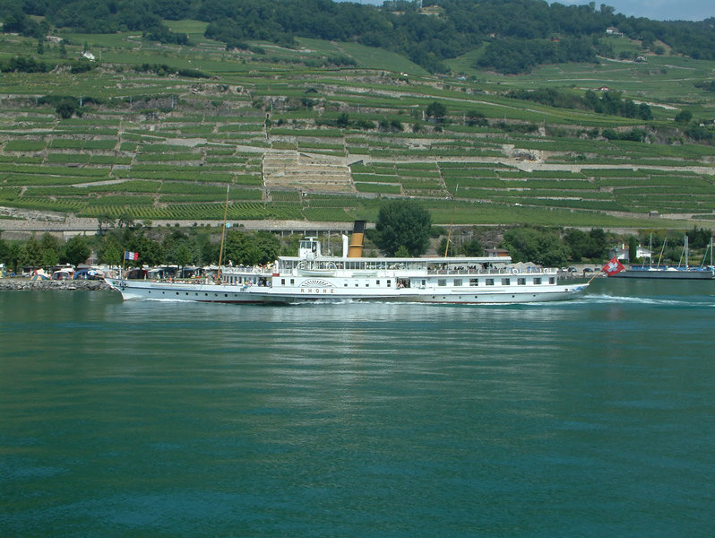 Paddle steamer  Rhone passing the Lavaux vineyards on the northern shores of 'Lake Geneva'.