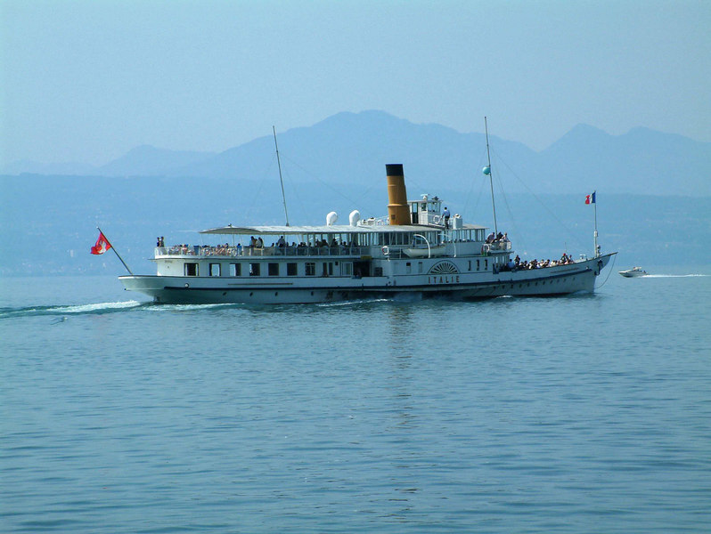 Diesel electric paddle vessel Italie leaving Lausanne Ouchy on her long daily return sailing from Le Bouveret to Geneva