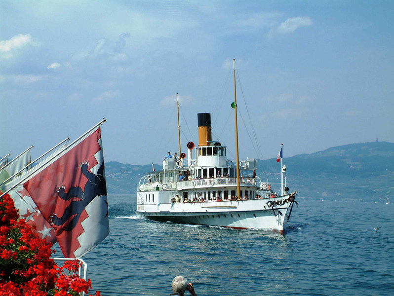 Paddle steamer Montreux arriving at St Gingolph from Evian