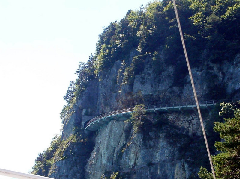 Views of one of the spectacular Swiss roads, pinned to the shear rockface on the northern shoreline of Lake Thun