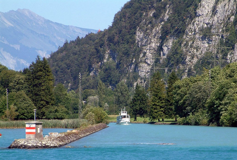 Motor vessel Spiez coming down the canal from Interlaken - the red and white painted post marks the start / end of the canal with the River Aare on the other side of the breakwater